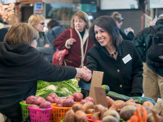 Republican Monroe County executive candidate Cheryl Dinolfo shakes hands with Georgianne Defranco-Cooper at the Public Market.