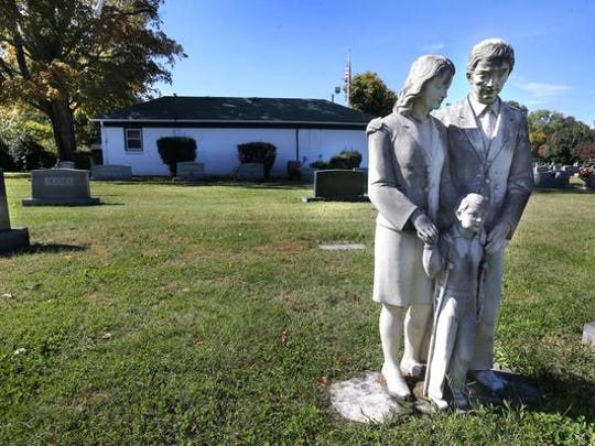 This is a statue that is not a grave marker at the Evergreen Cemetery on Tuesday, Oct. 20, 2015.