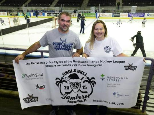 Bryan Lacasse, tournament director, and Serena Sisco, Junior Ice Flyers board member, are photographed at the Pensacola Bay Center where they are holding the Jingle Bell Jamboree youth hockey tournament. Pensacola is hosting five teams from Jacksonville, Orlando and Alabama.