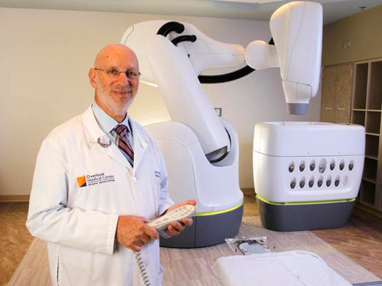 Dr. Louis Schwartz, chief of radiation oncology and medical director of the CyberKnife Center, with CyberKnife M6 control.