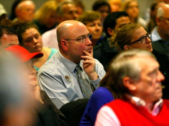 Eatontown residents listen to representatives from  Monmouth Mall, talk about  new plans for Monmouth Mall during public meeting at Eatontown Borough Hall.