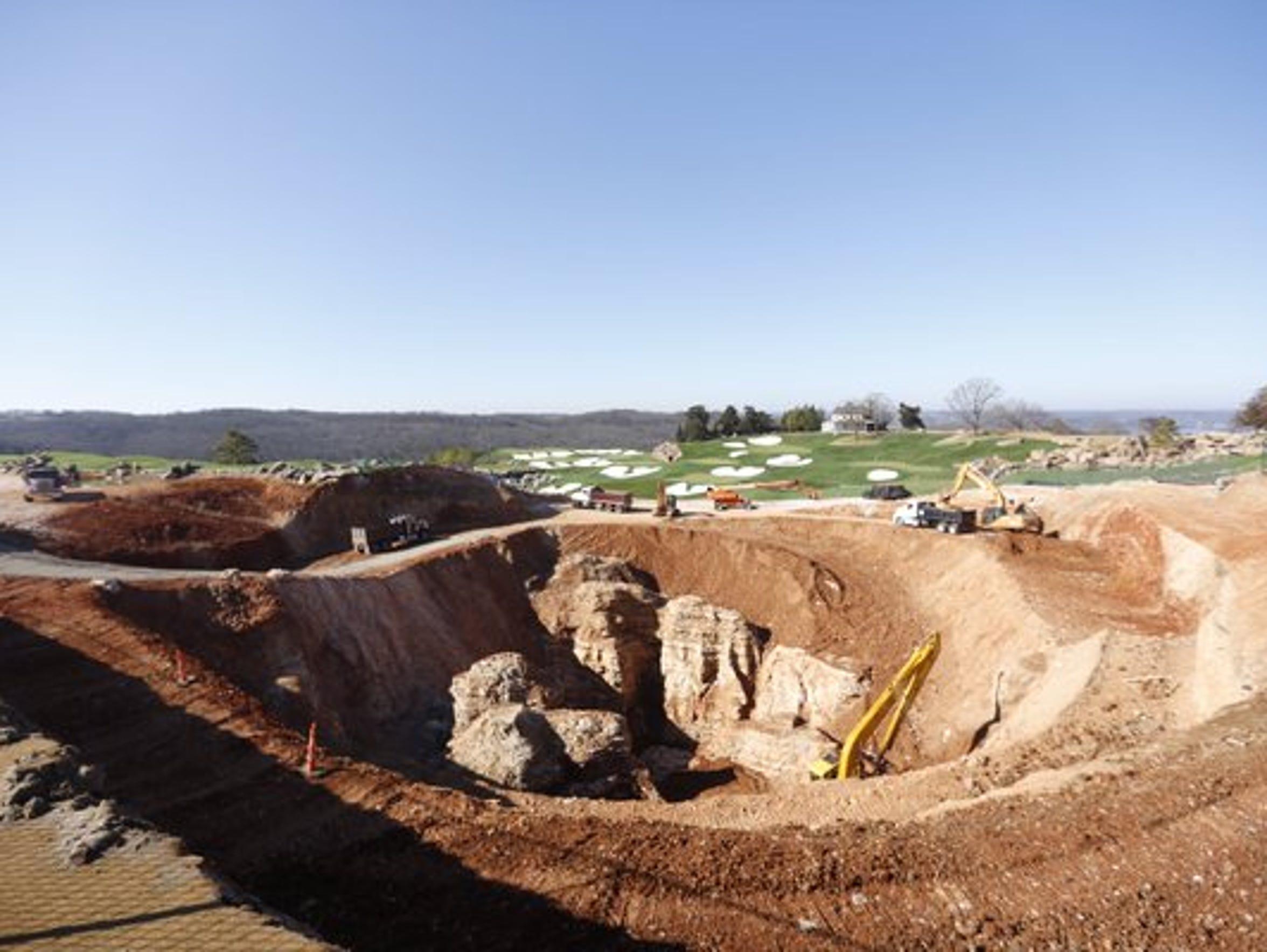 Pillars of rock are being exposed by excavator crews.