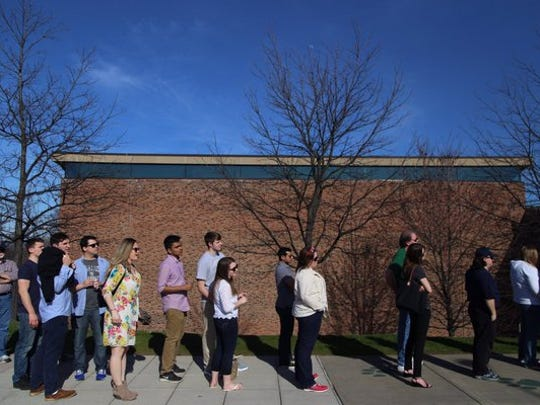 The line builds to see Bill Clinton at Binghamton University on Saturday.