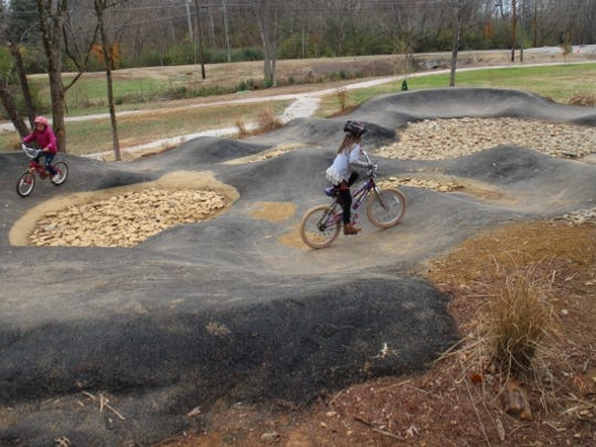 Lindy Gladson and Ella Anderson Riley enjoy the paved Junior Pump Track at the Baker Creek Preserve.