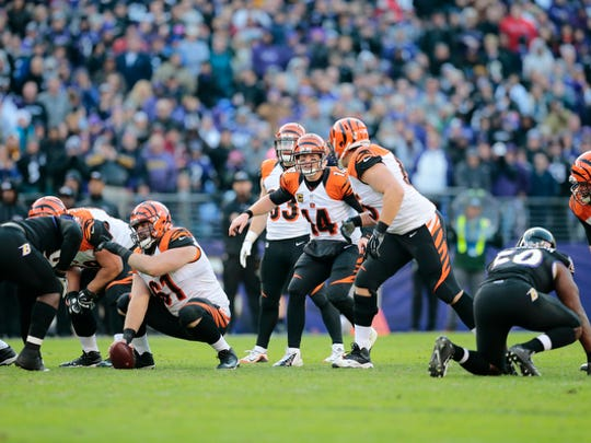 Guard Clint Boling turns around to get the snap count from Andy Dalton.