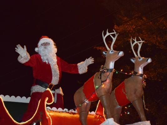 Santa Claus makes an appearance at the Pineville Christmas Parade held Friday, Dec. 10, 2015.