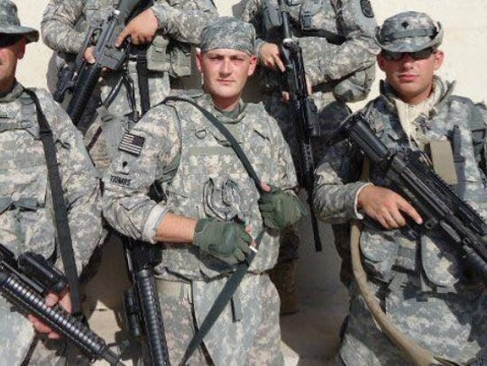 Sgt. John Toombs, center, committed suicide at the