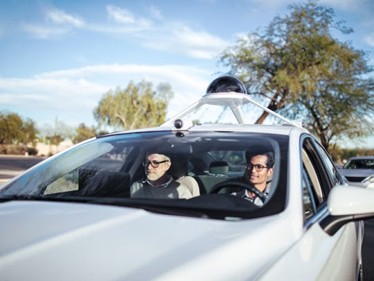 Two Intel employees test out a self-driving car in