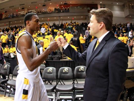 VCU athletic director Ed McClaughlin, right, said the