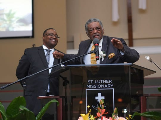 Pastor Charles Polk Sr., right, seen here with his