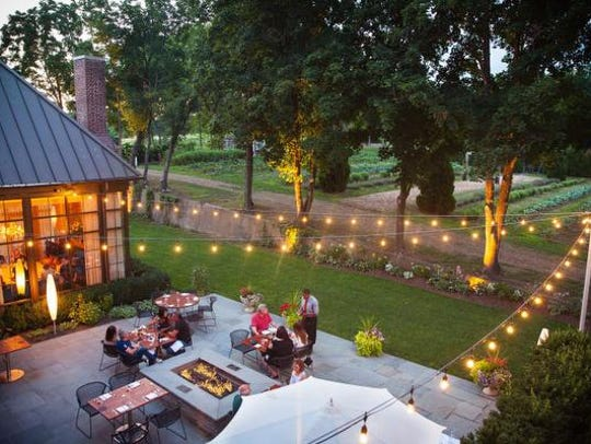 Diners enjoy a meal overlooking Ninety Acre's sustainable