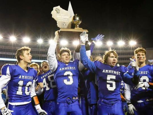 Amherst High School's football team claims the victory