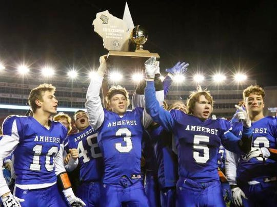 Amherst High School's football team claims the victory against Lake Country Lutheran High School during WIAA division 5 state championship Thursday, Nov. 16, 2017, at the Camp Randall Stadium in Madison, Wis.