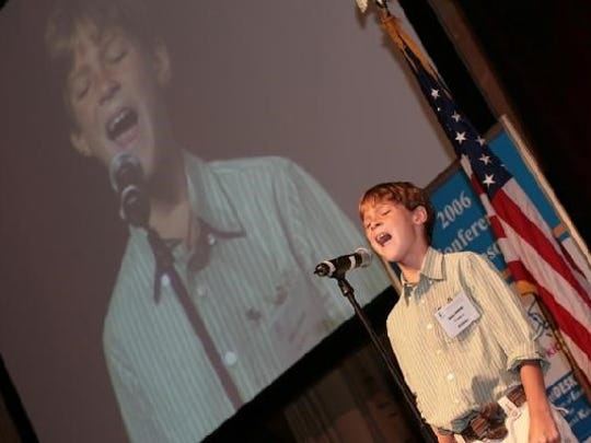 Noah Jack Cummins sings at the National Autism Conference in Rhode Island in 2006.