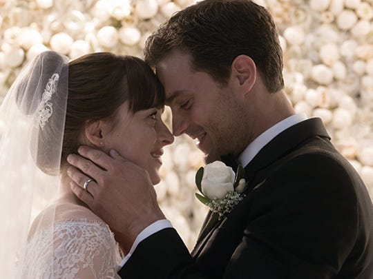 """DAKOTA JOHNSON and JAMIE DORNAN return as Christian Grey and Anastasia Steele in """"Fifty Shades Freed,"""" the climactic chapter based on the worldwide bestselling """"Fifty Shades"""" phenomenon.  Bringing to a shocking conclusion events set in motion in 2015 and 2017's blockbuster films that grossed almost $950 million globally, the film arrives for Valentine's Day 2018."""