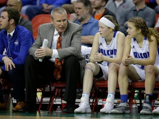 Amherst coach Gregg Jensen talks to this daughter Geena on the bench during their Division 3 championship game at the WIAA state girls basketball tournament.