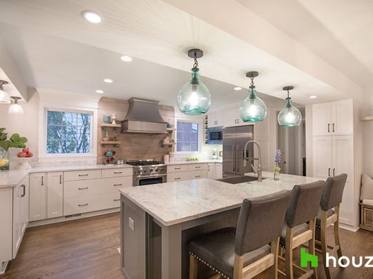 """Green Bay Packers linebacker Clay Matthews surprised his brother, Brian, and sister-in-law, Megan, with a new kitchen remodel as part of a renovation of their Cleveland home for the new episode of """"My Houzz."""""""
