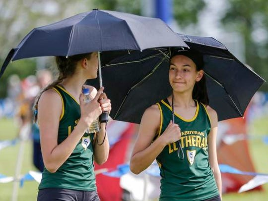 Sheboygan Lutheran's Carly Schreurs, left, and teammate