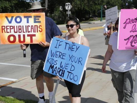 636659884394062098-Families-Belong-Together-Protest-Wisconsin-Rapids-063018-005.jpg
