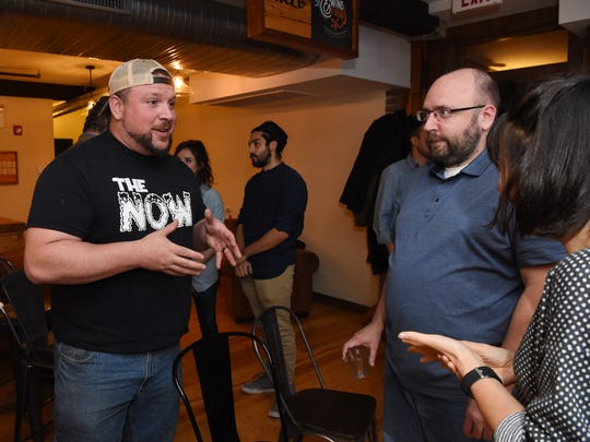 Rob Begley, left, of Red Hook, talks with Phil Strum, center, a producer at the Poughkeepsie Journal, and Alecia Eberhardt-Smith, right, of Kingston during the Hudson Valley Forward kickoff event at the Poughkeepsie Underwear Factory in the City of Poughkeepsie.