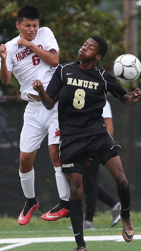From left, Sleepy Hollow's Dennis Ferran (6) and Nanuet's  Cyle Warner (8) battle for ball control during boys soccer game at Washington Irving School in Tarrytown Sept. 19,  2017. Nanuet won the game 6-2.