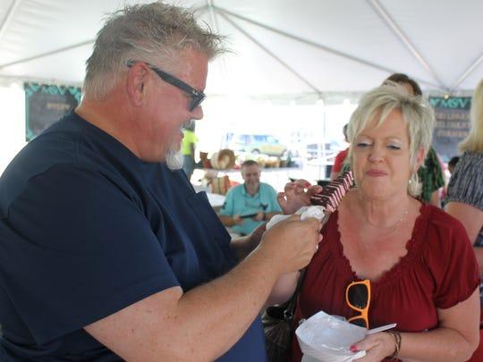 Brett Spivy and Debra Burkheart share a raspberry piesicle