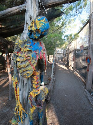 The KLAQ Haunted Forest, in a paintball field, is decorated with skeletons and other scary figures.