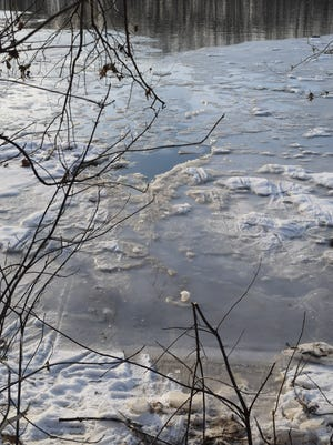 Photo of the icy White River, where IFD firefighters rescued a man early Thursday evening.