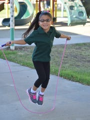 Hannah Anzaldua, 5, jumps rope while waiting for her kindergarten class to begin during the first day of school at John Kelley Elementary in Thermal on Wednesday, Aug. 17, 2016.