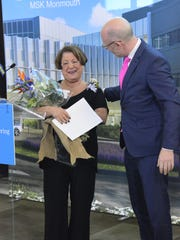 Dr. Jason Konner, chief of medical onocology at MSK Monmouth, presented flowers to cancer patient, Maria Rubbo, of Matawan, during the facility's grand opening on Monday.