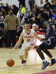Point Beach's Danny Frauenheim dribbles against the defense of the Ranney School in a game on Dec. 16, 2016.