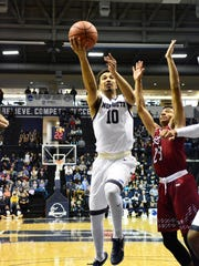 (SPORTS)        12/31/16        West Long Branch, NJ Monmouth's Micah Seaborn (left) drives to the basket against Rider on Saturday at Monmouth. Frank Galipo/Correspondent ASB 0101 Monmouth Hoops C