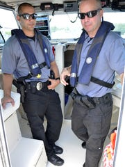 Ocean County Sheriff's Officers Mark Schilling (right) and Steve DeRosa (left) aboard the James J. Mancini at Dillon's Creek Marina in Island Heights.