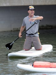 Paddle Out Manasquan instructor Bruce Juska gives direction