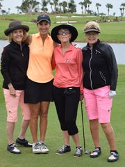 Golfers at Hammock Bay Golf & Country Club for the 5th annual golf tournament.