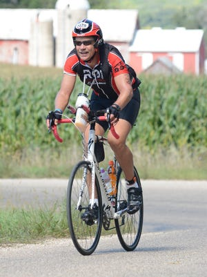 Robb Greenawald competes in the cycling portion of the 2015 Iron Madison triathalon