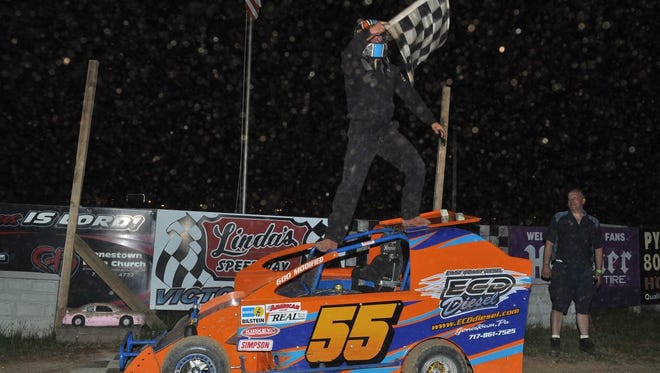 Michael Burrows celebrates his win Friday at Linda's Speedway in a 600 Modified race.