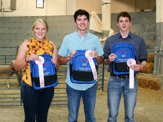 Earning a runnerup finish in the overall senior division standing and a trip to the national competition was the team from Iowa County consisting of (from left) Morgan Vondra, Brady Palzkill and Brandon Springer.