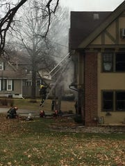 Fire crews on the scene of a house fire in the 5300 block of Grand Avenue on Friday morning.