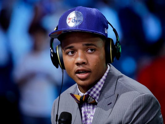 FILE - In this June 22, 2017, file photo, Washington's Markelle Fultz answers questions during an interview after being selected by the Philadelphia 76ers as the No. 1 pick overall during the NBA basketball draft in New York. Fultz needed to be helped off the court with an injury to his left ankle in the 76ers' summer league game Saturday, July 8, against Golden State. (AP Photo/Frank Franklin II, File)