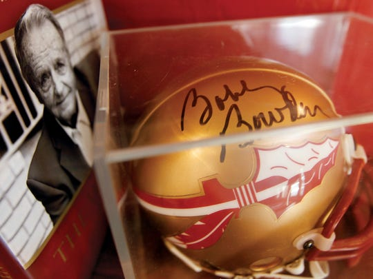A Bobby Bowden book and signed helmet is part of fan Tod Bayne's memorabilia collection.