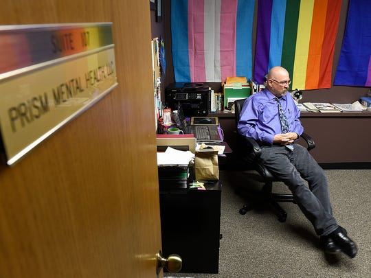 Licensed professional counselor Patrick RichardsFink operates Prism Mental Health, shown in his office Thursday, July 14, in St. Cloud.