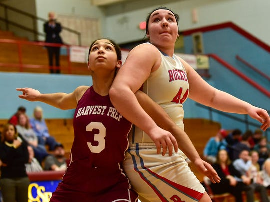 Ridgedale's Kerry Pauly and Harvest Prep's Mary Healy both have their eye on the rebound during the D-IV sectional tournament title game on Wednesday.