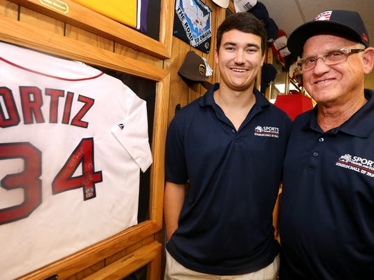 "Grandson and Grandfather Parker Bell and Kenneth ""Coon"" Victory stand next to Red-sox first baseman and designated hitter David Ortiz's jersey at Victory's home, on Thursday, Aug. 24 ,2017. The 2 visited all 30 major league baseball parks together."
