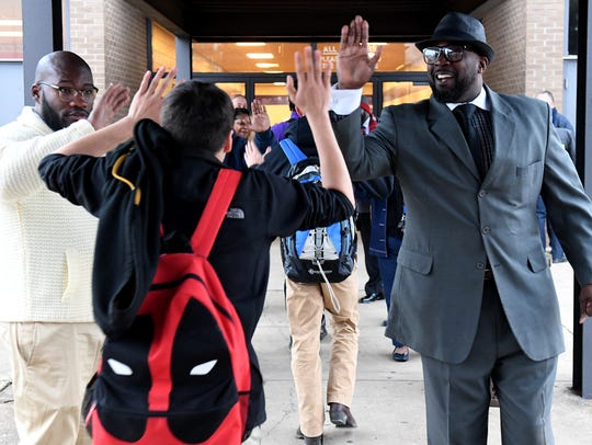 Shaheed Madyun and Pastor Undrae Johnson receive high-fives