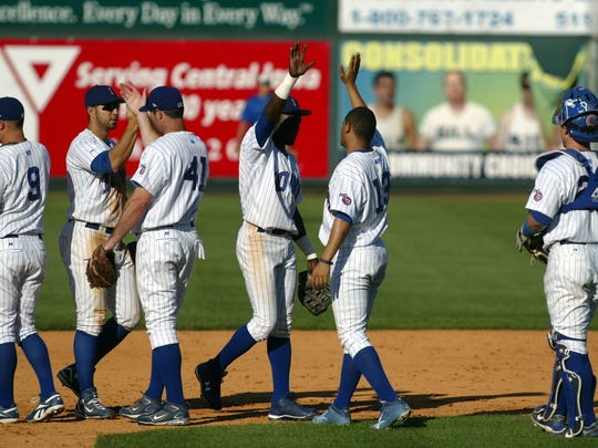 owa Cubs teammates high-five following their 5-4 win over the Nashville Sounds on June 14, 2008. Principal Park was empty due to the order to evacuate the area following flooding.  DANIEL SATO/THE REGISTER