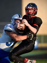 Sartell defensive lineman Mitchell Zayas sacks Rocori