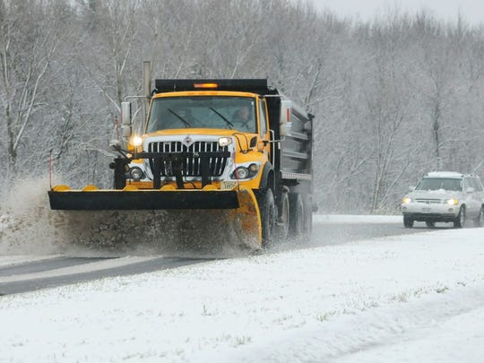 A Brown County snowplow clears the roundabouts at Cty FF and State 29 in Hobart on Monday, Nov. 10.
