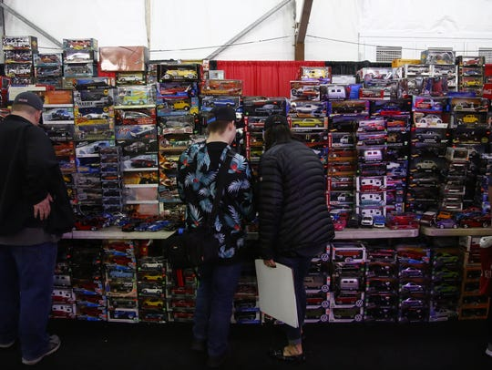 People browse miniatures cars as well as the big versions