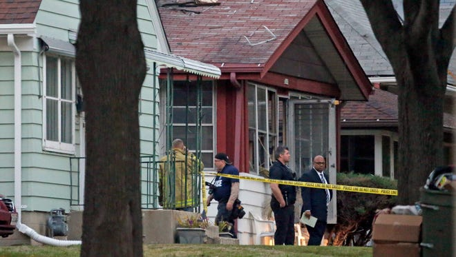 Investigators work at the scene of a fatal house fire in the 5600 block of N. 36th St. on Oct. 20, 2015. Michael A. Morgan, 27, was convicted of two counts of first-degree reckless homicide, arson, bail jumping and other offenses in connection with the fire, which killed two of the six children staying there with his estranged wife's mother.